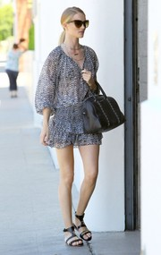 Rosie Huntington-Whiteley went for a breezy boho look in a printed peasant blouse by Isabel Marant for H&M.
