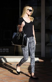 Rosie Huntington-Whiteley styled her top with a pair of black-and-white leopard-print pants by 7 For All Mankind.