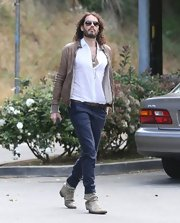 Russell Brand traded in his typical skinny denim in favor of a more dressed up skinny pant for his appearance at a California school.