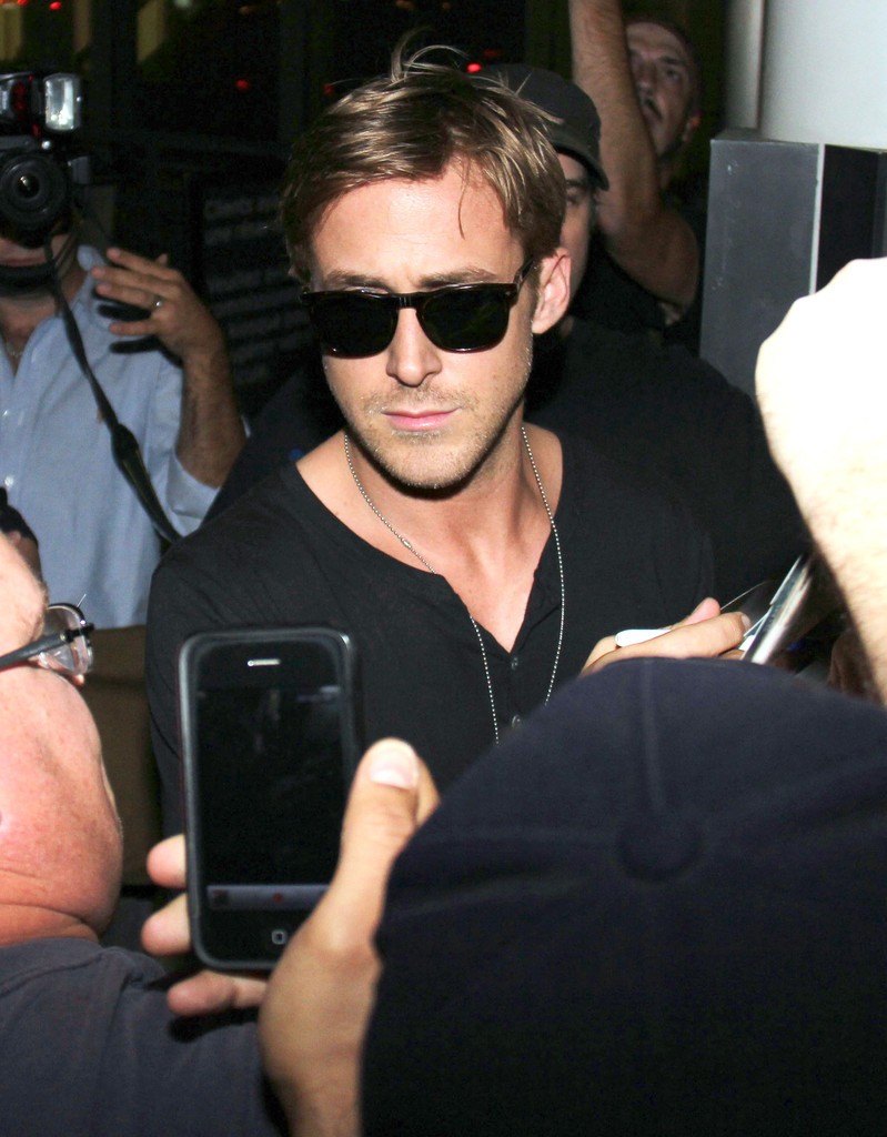 7a28408f91 Ryan Gosling wore dark glasses as he hurried through the crowd of Canadian  paparazzi waiting for