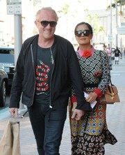Salma Hayek topped off her ensemble with oversized sunglasses.