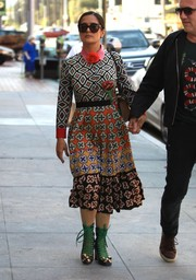 Salma Hayek finished off her look with a pair of bow-adorned lace-up boots, also by Gucci.