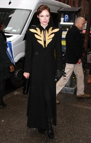 Coco Rocha looked very formal in an ankle-length black coat with an embellished neckline during the Cosmo 100 luncheon.