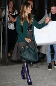 Sarah Jessica Parker teamed a green Chloe cross-body tote with a matching blazer and a black mesh dress for a day out in New York City.