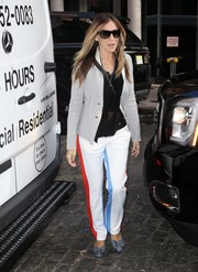 Sarah Jessica Parker injected a sporty touch with a pair of red, white, and blue side-striped track pants by Tory Sport.