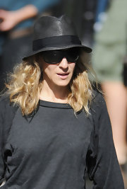 Sarah Jessica Parker showed off her casual side in a sweatshirt and fedora hat.