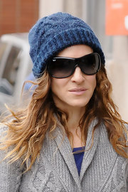 Even while walking her tots to school, SJP still remains her stylish edge. She topped her cozy look off with a wool beanie and black rectangle shades.