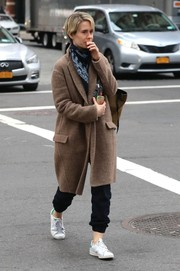 Sarah Paulson bundled up in a tan wool coat for a stroll in New York City.