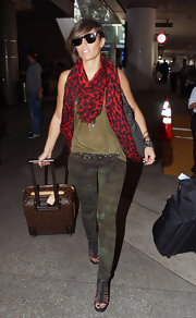 Frankie Sandford kept her look muted with this green and brown printed pant.