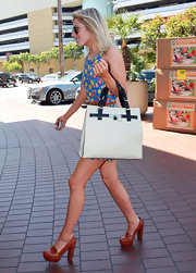 A big fan of High Street, Mollie King added polish to her street style with a structured white leather bag with contrasting black handles.