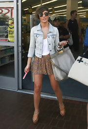 Frankie Sandford layered a light denim jacket over a ditsy print skirt and a loose white tank.