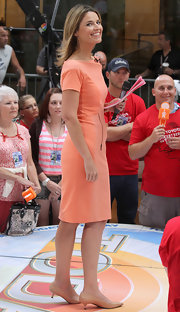 Savannah Guthrie looked lovely in this knee-length coral dress as she introduced Carrie Underwood to the stage during the 'Today' show in NYC.