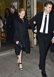 Scarlett Johnansson accessorized her all black look with a chic quilted leather clutch.