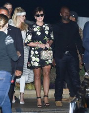 Kris Jenner paired her lovely dress with embellished black sandals by Alaia.