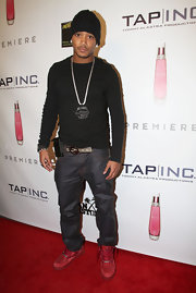 Romeo Miller attended Sean Kingston's birthday wearing red high-top sneakers.It was the perfect way to add a pop of color to his casual look.