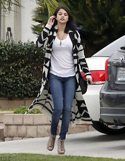 Selena paired her wild blue hair with cutout lace-up booties.
