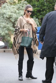 Selena Gomez was hippie-chic in a striped nude poncho while running errands in LA.