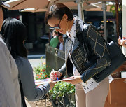 Selita Ebanks signed an autograph at the Grove in this studded leather jacket and star print top.