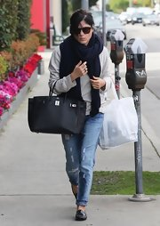 Selma Blair bundled up in style with this navy blue oversized scarf.