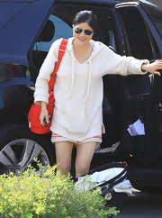 Selma Blair matched an adorable pair of striped shorts with a cozy knot hoodie.