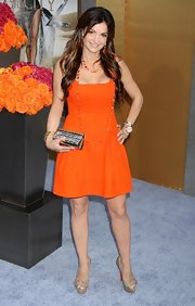 Beth Shak looked darling in a bright orange sleeveless dress.