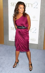 Vanessa acessorized her raspberry-hued cocktail dress with a thick, studded metallic belt.