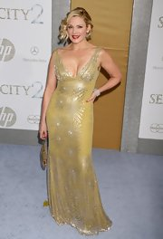 Kim sparkled in a sleeveless gold gown with a deep v-neck and sunflower embroidery.