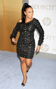 Ashanti wore a sleek high ponytail with dramatic eye makeup and an embellished LBD.