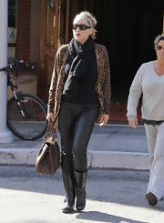 Sharon Stone opted for flat leather boots while out and about town.