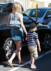 While out with her son, Sharon Stone showed off her grey quilted shoulder bag.