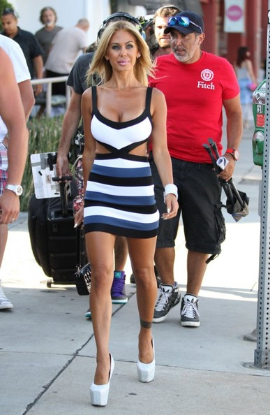 Shauna Sand traded in her customary lucite heels for a pair of dizzyingly high white platform pumps for a shoot in LA.