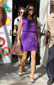 Shay Mitchell topped off her pretty purple dress with a pair of platform peep-toe pumps—note how the purple platform matches her purple dress!