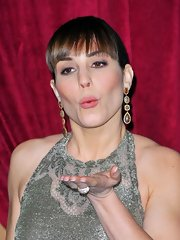 Noomi Rapace added some color to her neutral outfit with a pair of dangling gemstone earrings when she attended the 'Sherlock Holmes 2' LA premiere.
