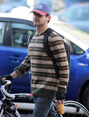 Shia LaBeouf went for a bike ride in Vancouver wearing a patterned crewneck sweater.