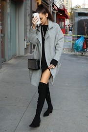 Bella Hadid bundled up in a gray wool coat for a day out in New York City.