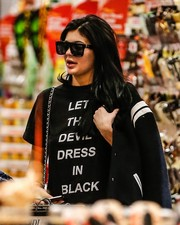 Kylie Jenner tried to keep a low profile with a pair of angular shades.
