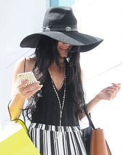 Vanessa Hudgens looked a little shy wearing this wide-brimmed hat while shopping in Beverly Hills.