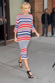 Sienna Miller headed to 'The Tonight Show' looking vibrant in a striped knit dress by Celine.