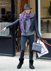 Sienna went shopping in her printed Louis Vuitton stole.
