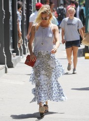 For a chicer finish, Sienna Miller paired her top with a mixed-print, layered skirt by Stella McCartney.