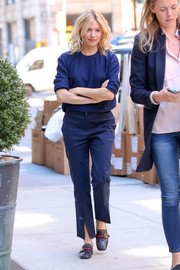Sienna Miller headed out in New York City wearing a plain navy crewneck sweater.