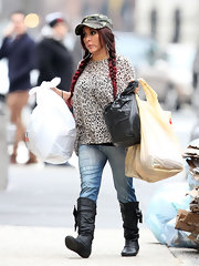 A supposedly pregnant Snooki tucked her distressed denim into flat boots fora funky take on street style.