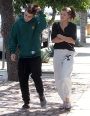 Sofia Richie topped off her pants with a black henley shirt.