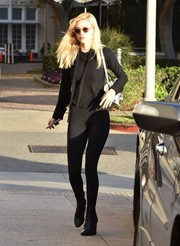 Nicola Peltz flaunted her super-slim legs in black leggings.
