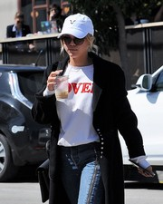Sofia Richie kept the sun out with a white baseball cap and a pair of shades.