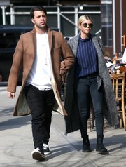 Sofia Richie layered a gray wool coat over her outfit for some warmth.