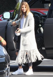 Sofia Richie went hippie in a long gray shawl-collar cardigan with a fringed hem for a day of shopping.