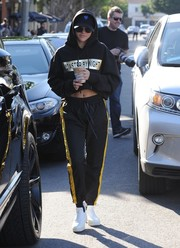 Sofia Richie kept the sporty vibe going with a pair of side-striped track pants by Daniel Patrick.