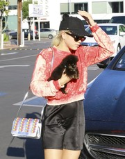 Sofia Richie accessorized with a funky Moschino Pill Pack bag (and a cute puppy) while out in West Hollywood.