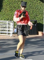Sofia Richie teamed her top with a black satin mini skirt.